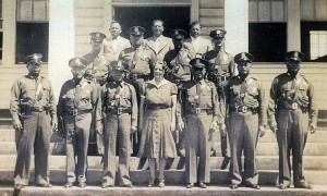 Edna Jenkins, Maui Police officers and Court Staff at the Old Paia Courthouse in Paia, Maui at the time when Edna Jenkins was appointed as a State District Court Magistrate in the 1930s